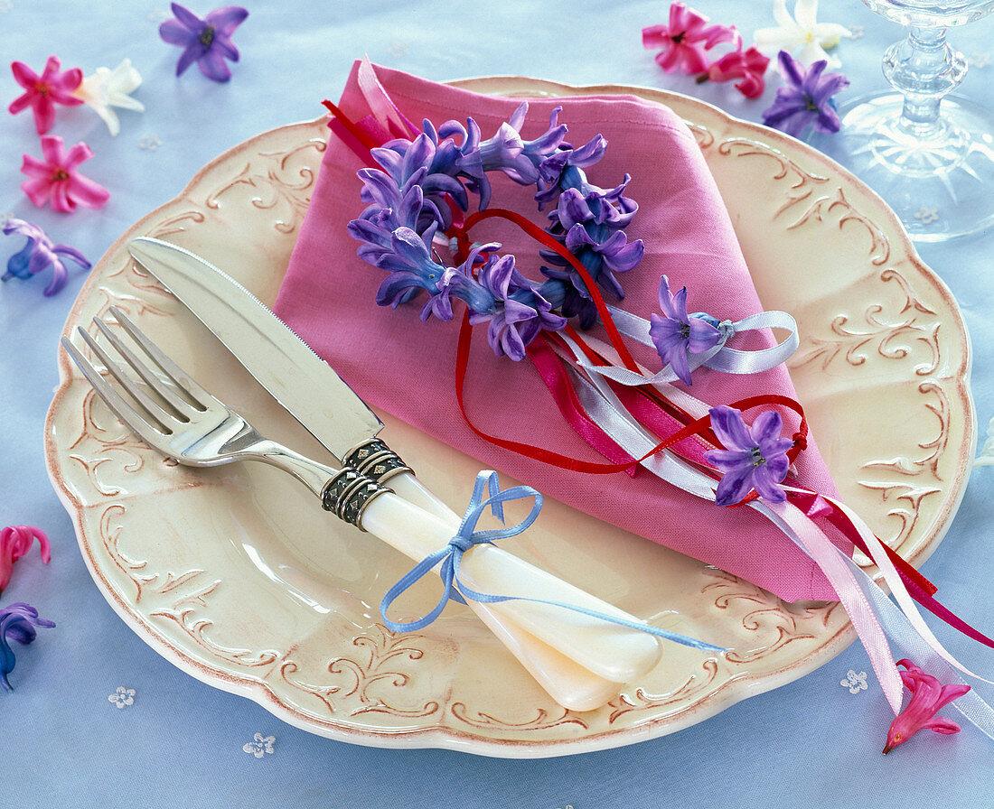 Wreath of blue Hyacinthus flowers on pink napkin