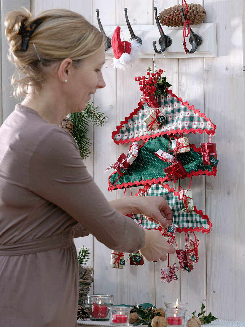 Self made advent calendar of fabric-covered wire hangers