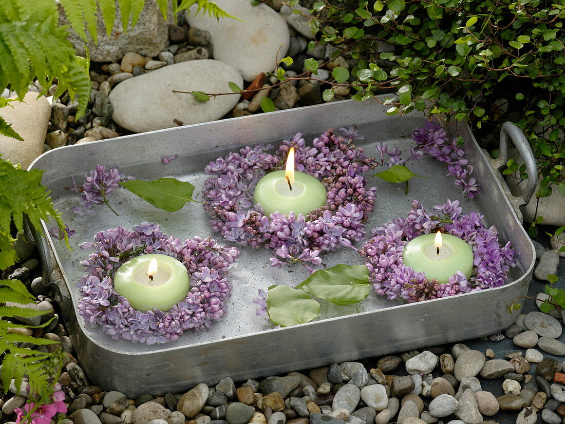 Small Syringa (lilac) wreaths with floating candles