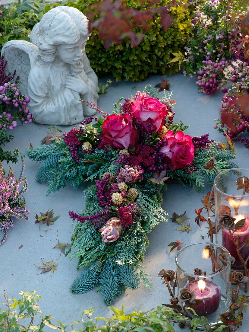 All Saints' Day arrangement in cross-shaped rose, protea, colored berries