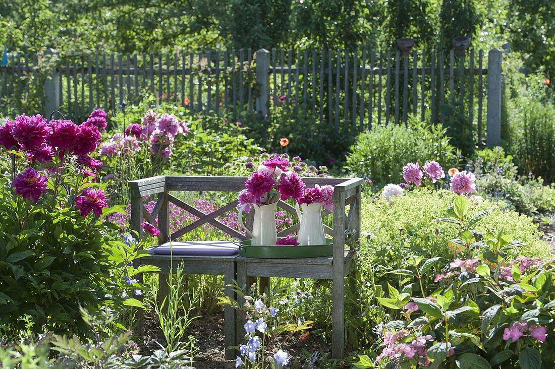 Romantic seat in the perennial garden