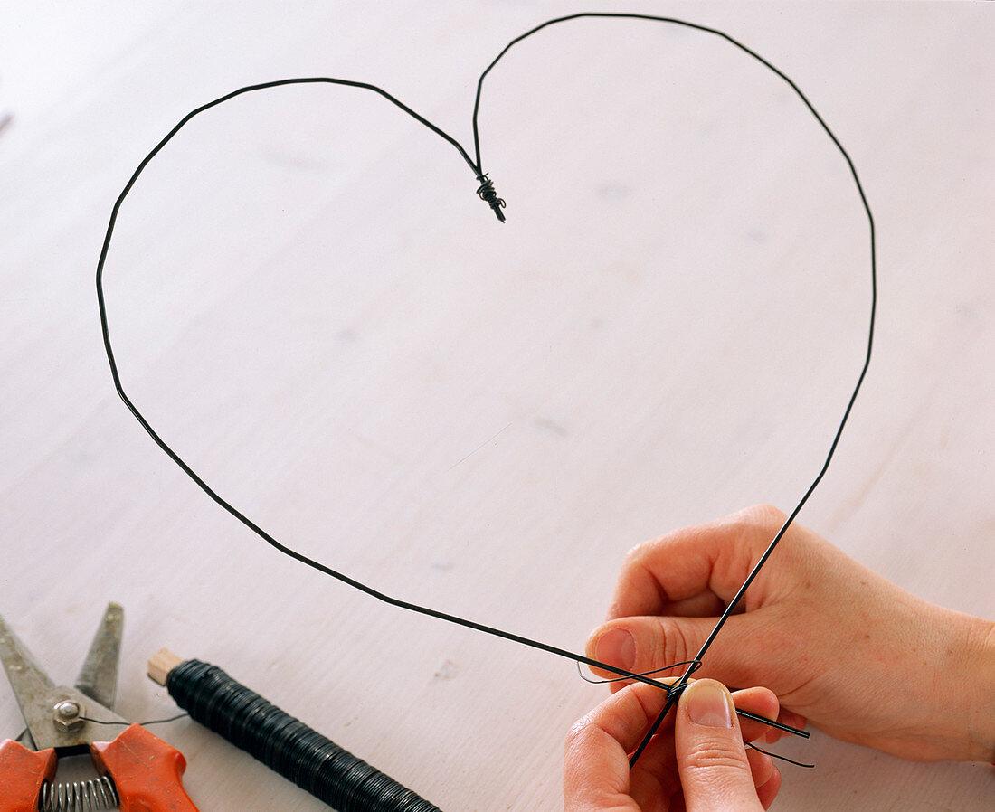 Heart of spring flowers, bend wire in heart shape