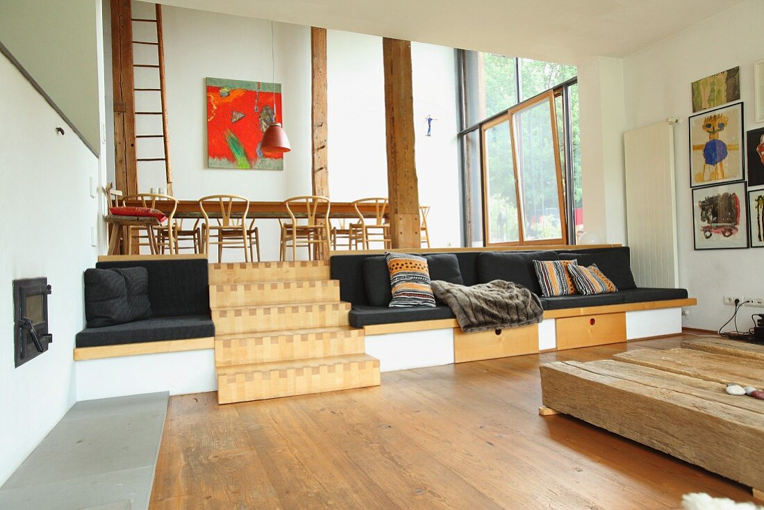 Split-level living area with integrated seating and wooden steps
