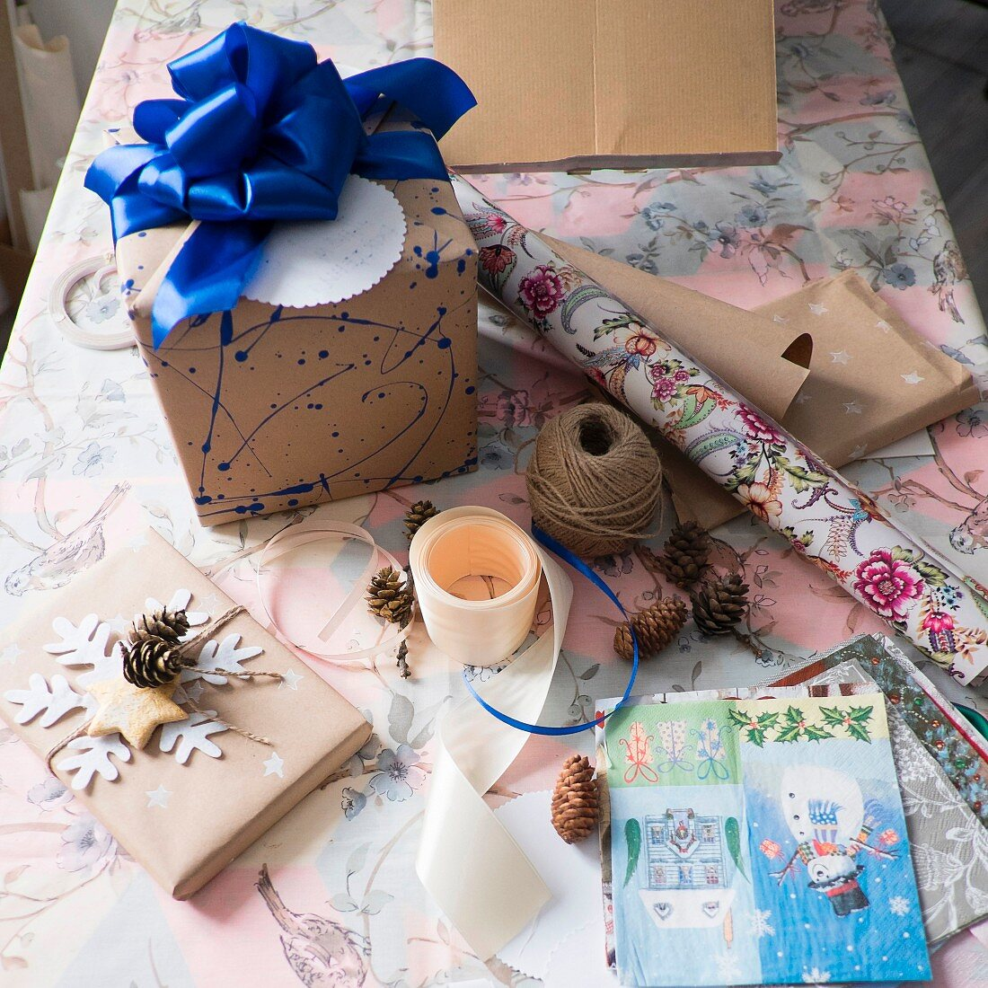 Wrapping materials and wrapped gift with blue ribbon