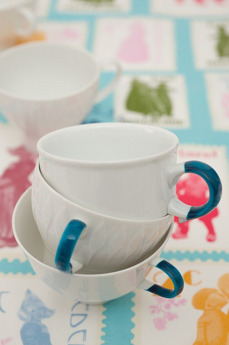 Cups with handles painted using china pens