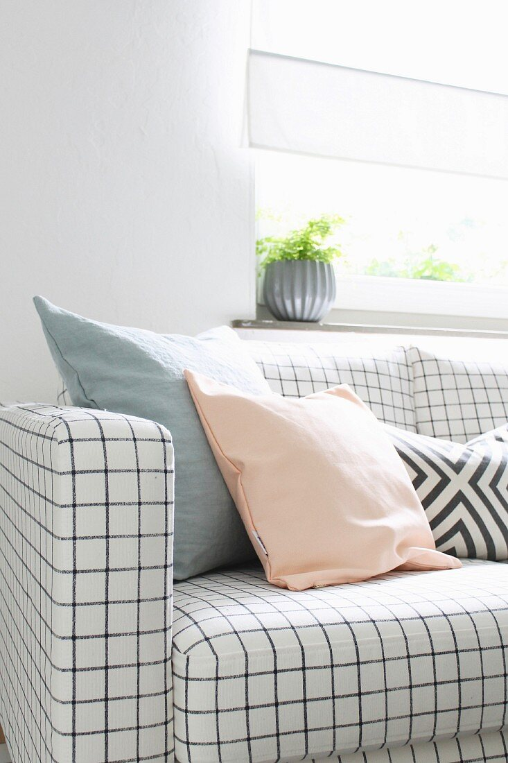 Sofa with checked upholstery and scatter cushions