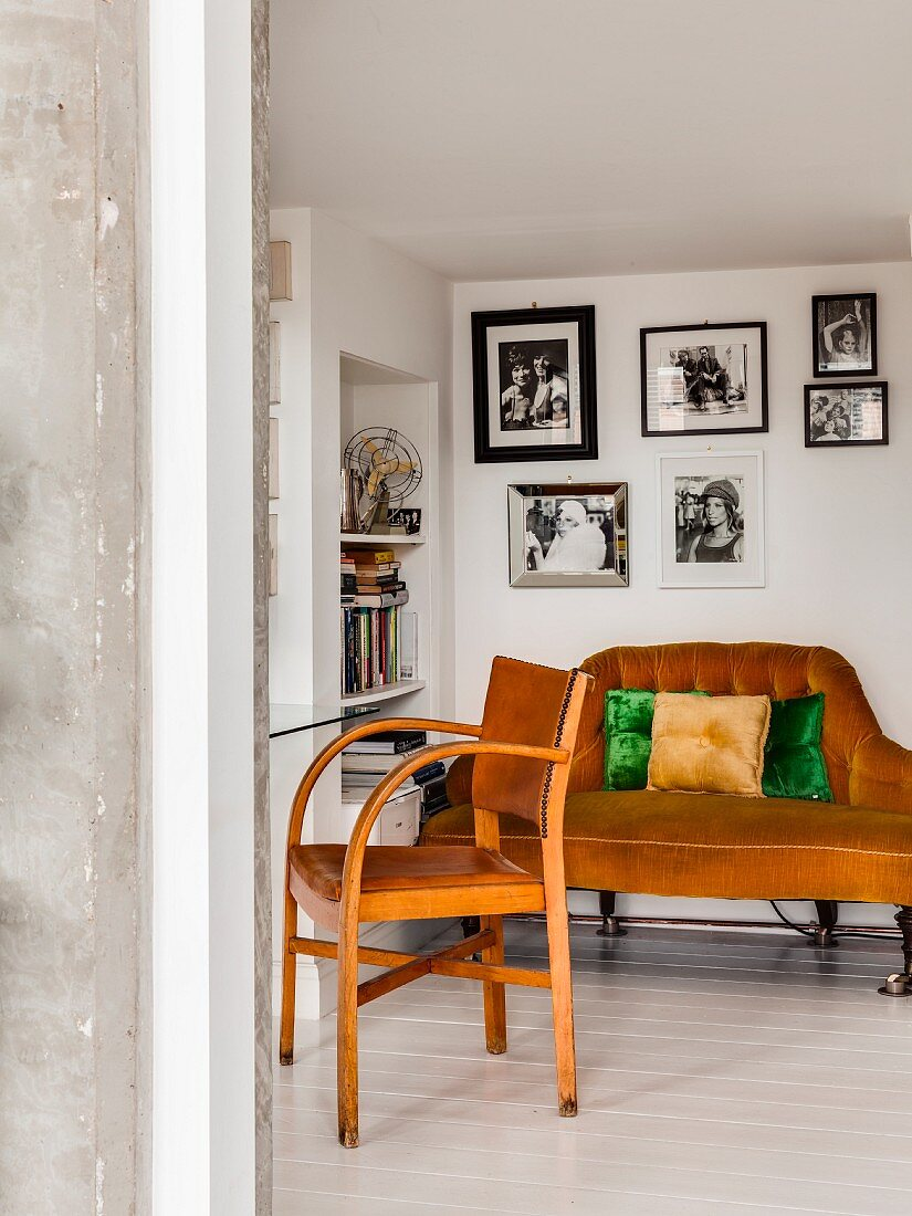 Sofa, bookcase and vintage armchair with leather seat and backrest