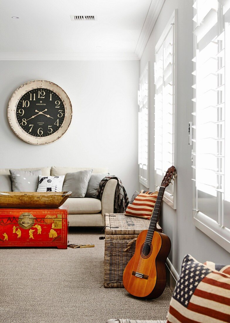 Bright living room with louvre windows and a mix of styles