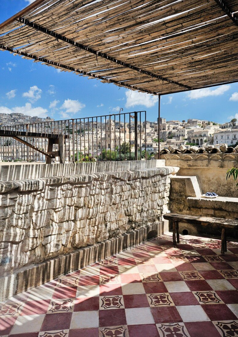 Traditional tiled floor and city view on Mediterranean roof terrace