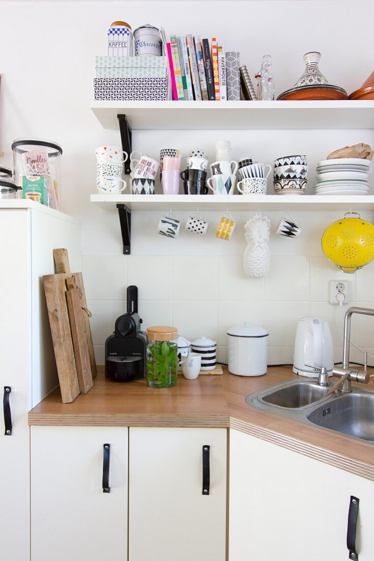 Wooden worksurface on angled kitchen counter with hand-made handles