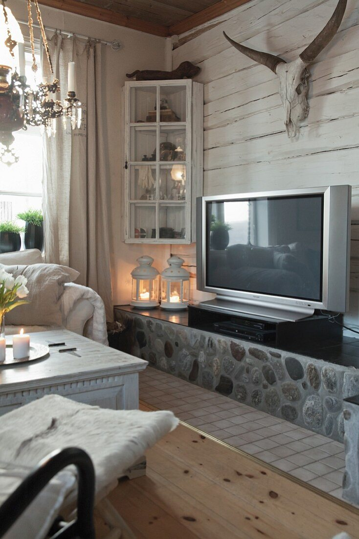 Bull's skull above TV in cosy living room
