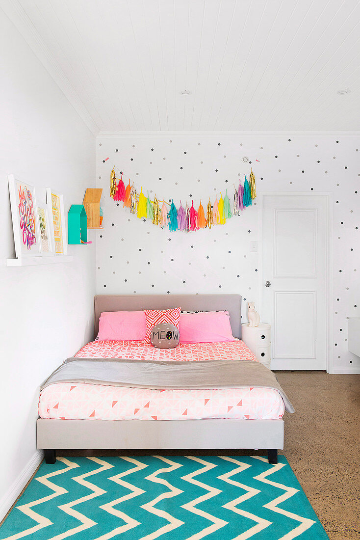 Tassel Garland Over The Bed Against A Buy Image 12404399 Living4media