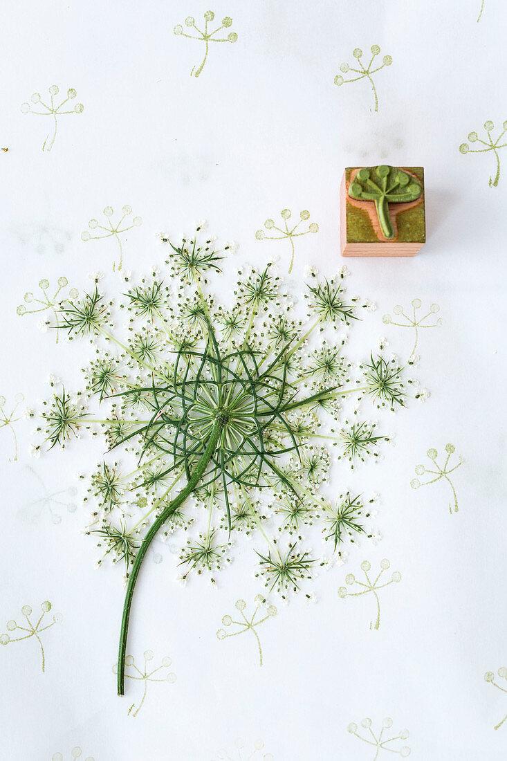 Wild carrot flower as a printing block motif