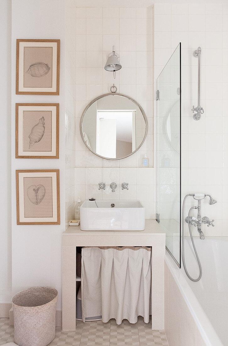 Masonry washstand base unit with curtain in beige bathroom