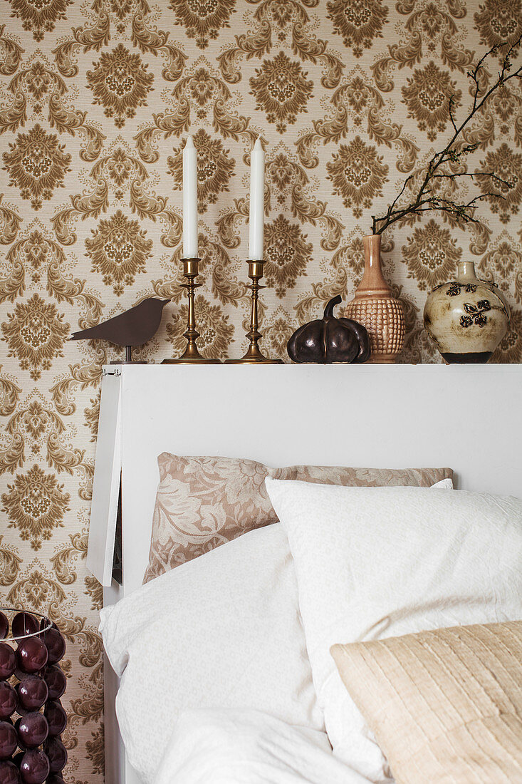 Retro wallpaper and bed headboard with storage space in bedroom
