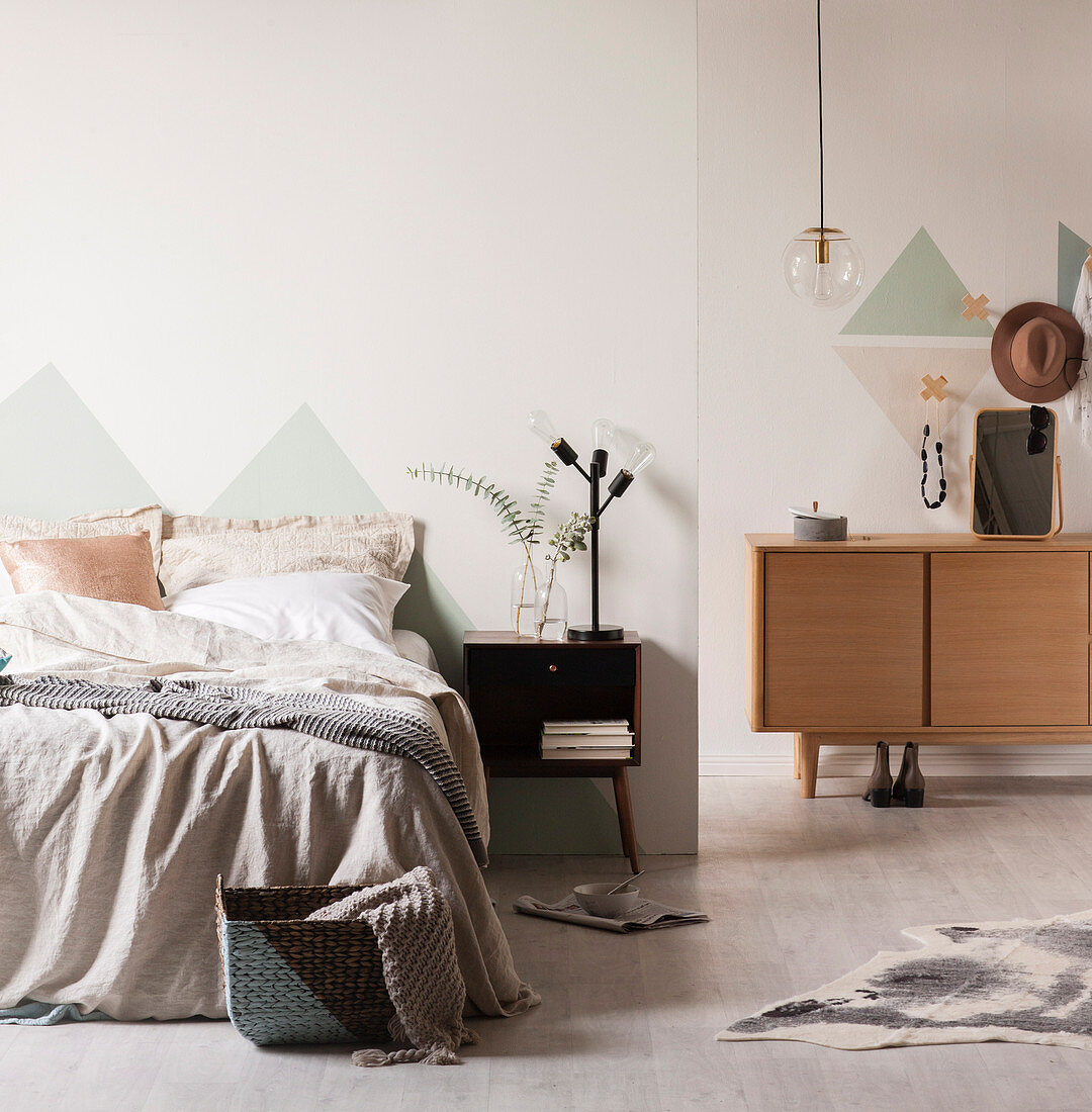 Pastel colored bedroom with triangles on the walls