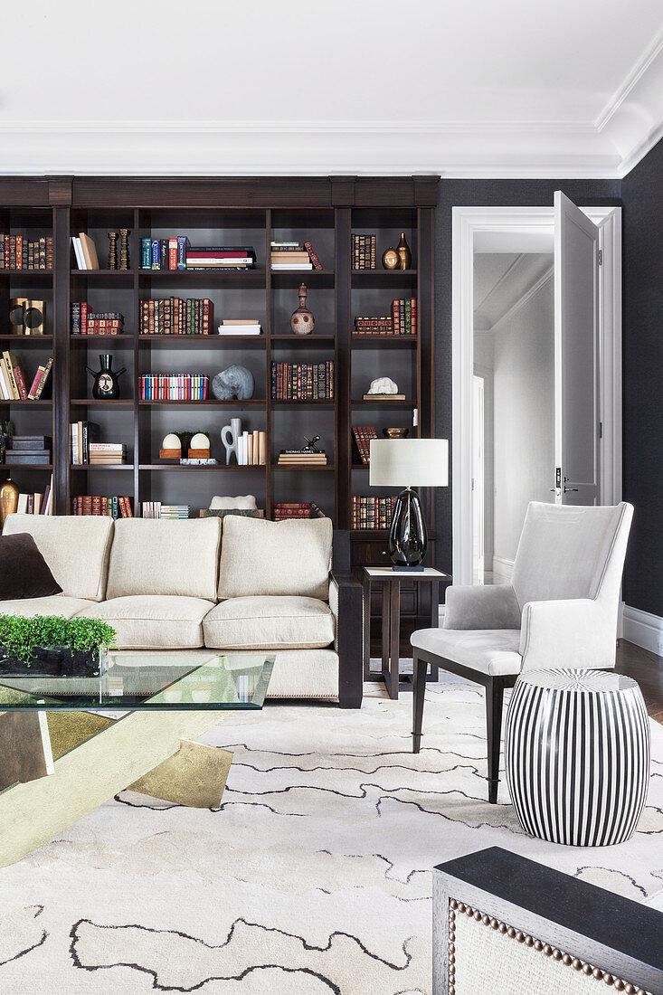 Dark shelf in elegant living room with light sofa and carpet