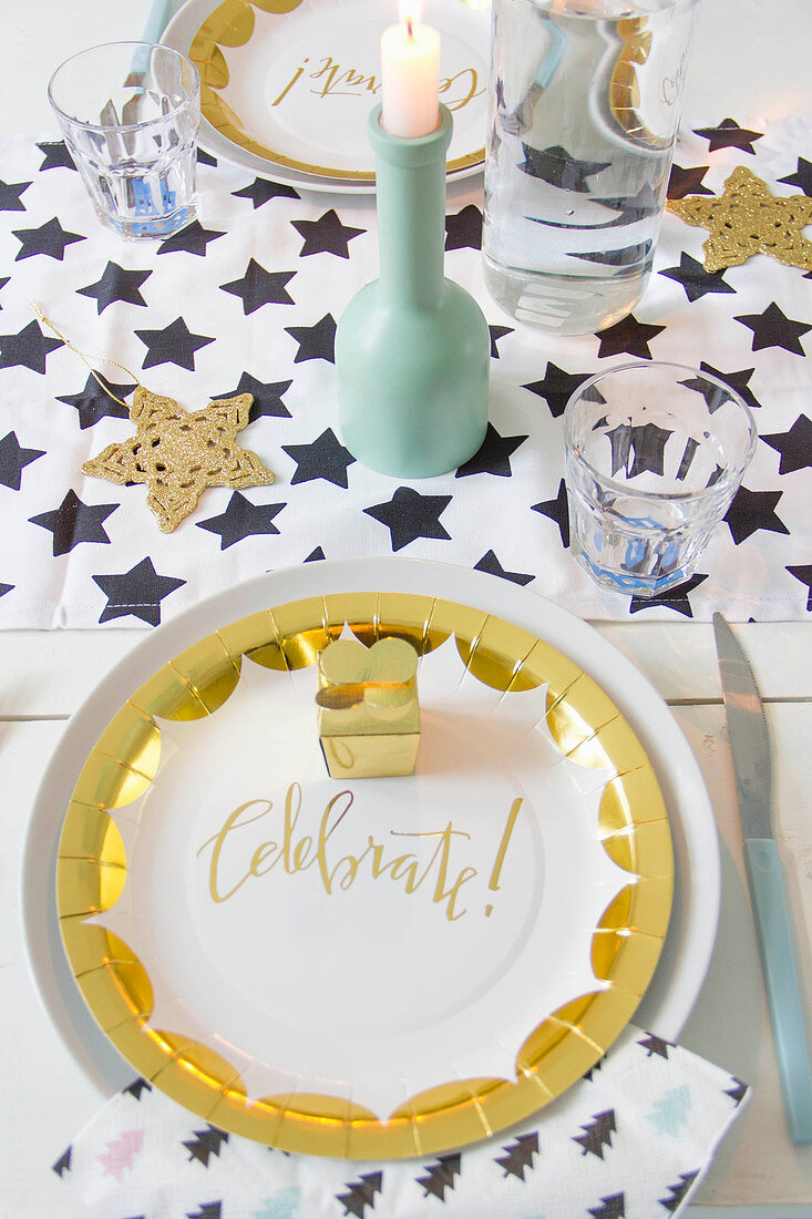 Table festively set with gold paper plates