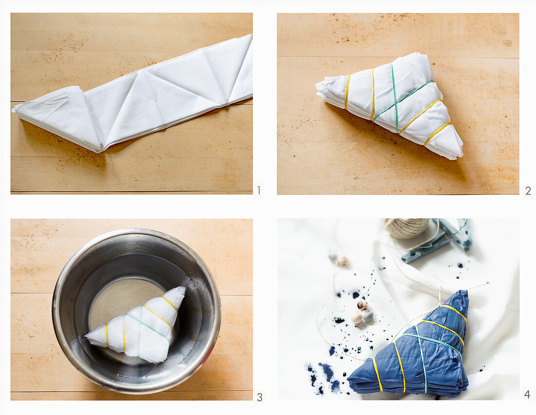 Dying place mats using Shibori technique: fold fabric, fix with rubber bands and soak