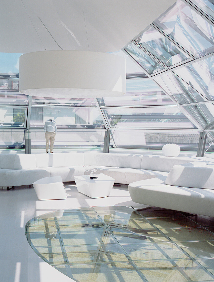 Futuristic living room with glass ceiling and glass floor