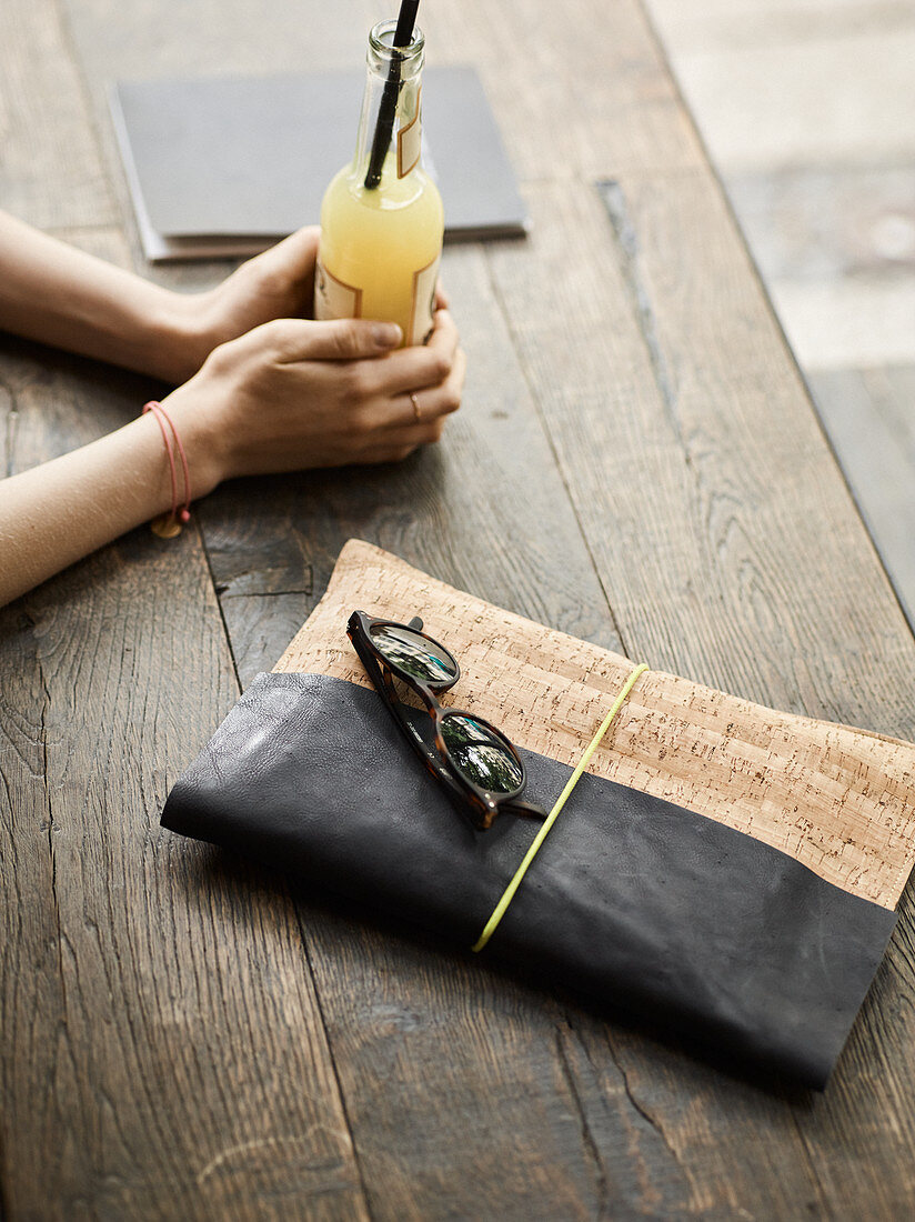 A homemade clutch made from leather and cork