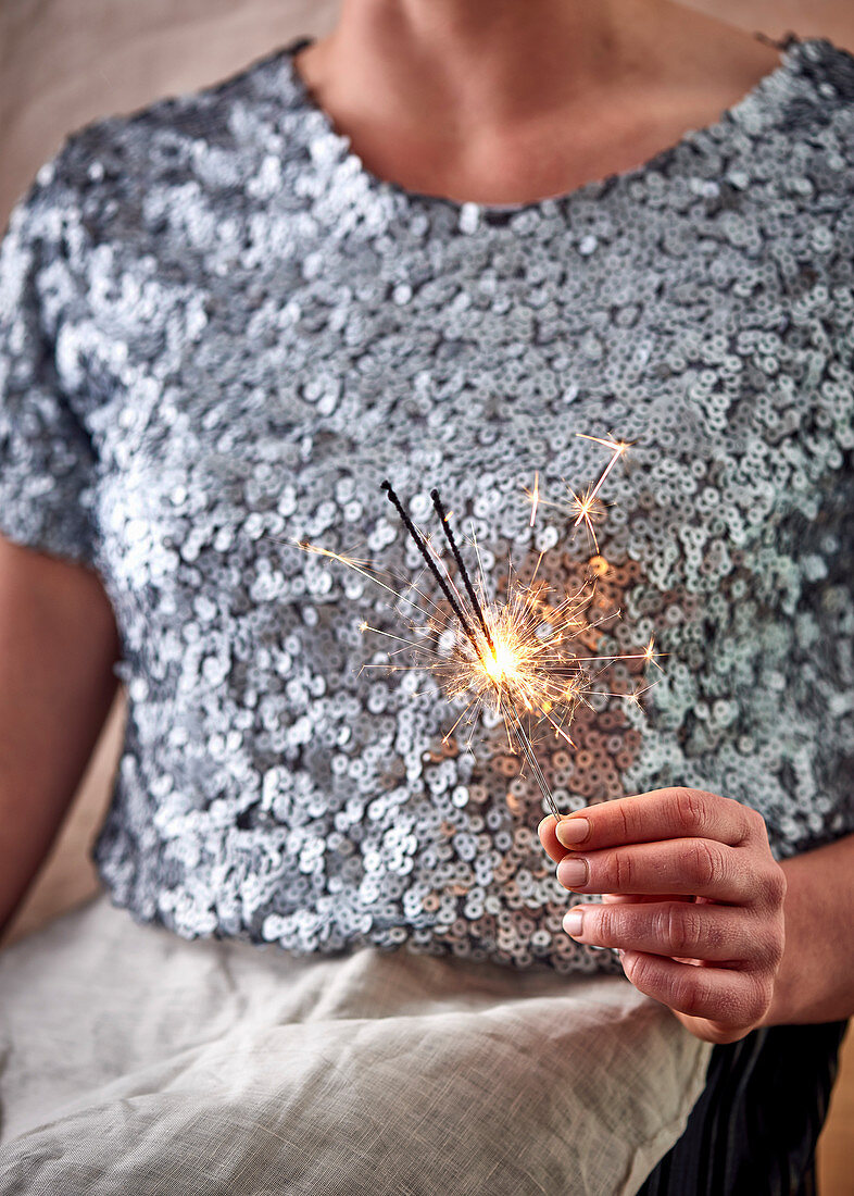 Woman holding sparklers at Christmas