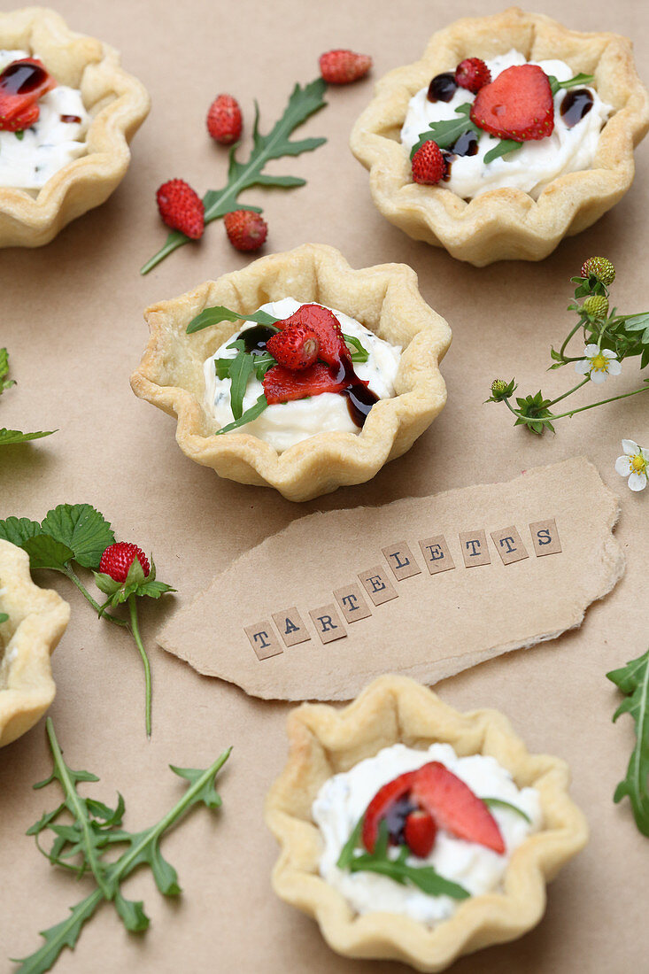 Goat cheese, wild strawberry and rocket tartlets