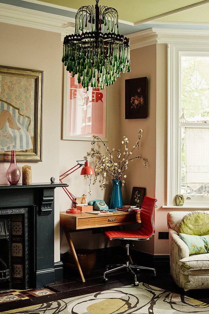 Green chandelier and desk in colourful living room