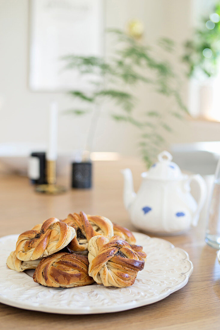Poppy seed pastries on white plate