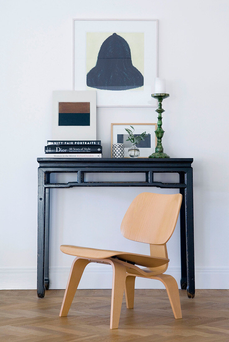 Scandinavian designer chair at Oriental console table
