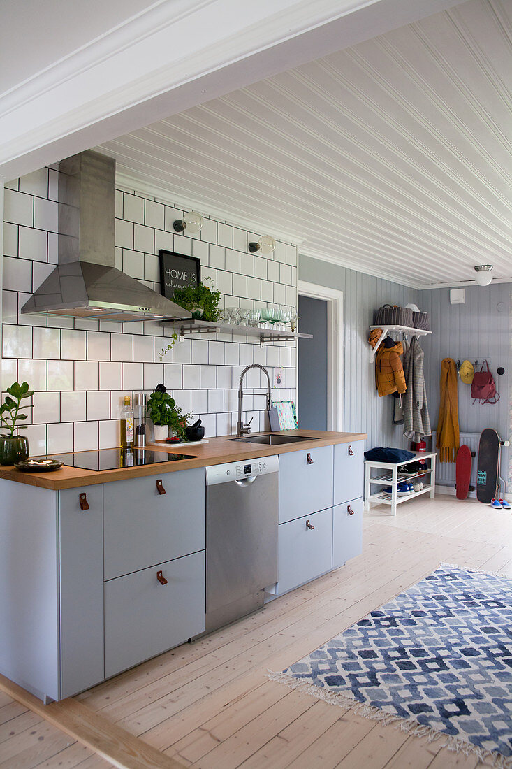 Grey Kitchen Counter Against Tiled Wall Buy Image 12470229 Living4media