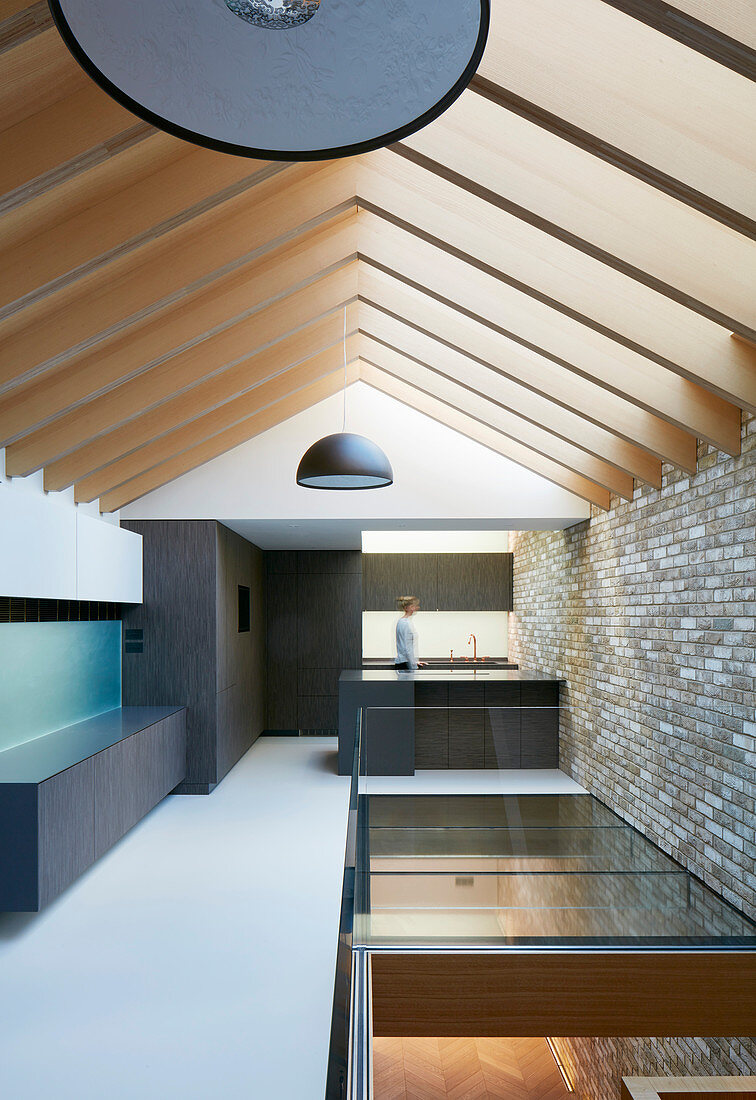 Open roof structure in modern architect-designed house in mixture of materials
