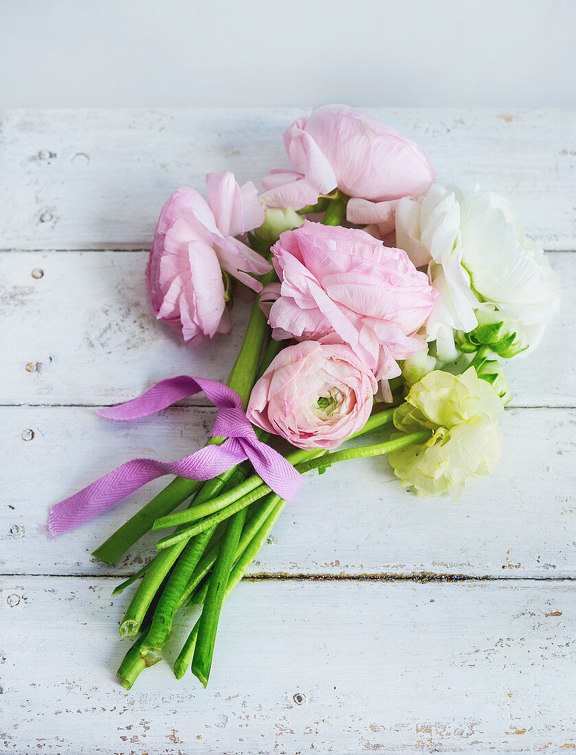 Posy of ranunculus on wooden surface