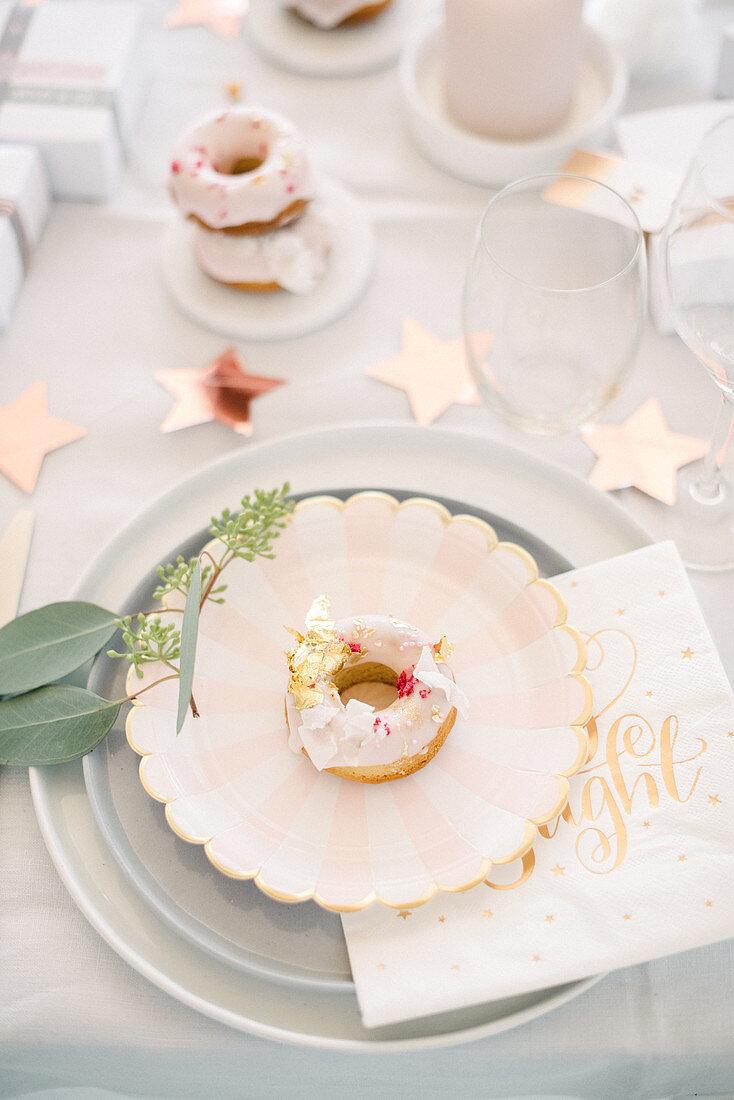 Donut on plate on modern Christmas table