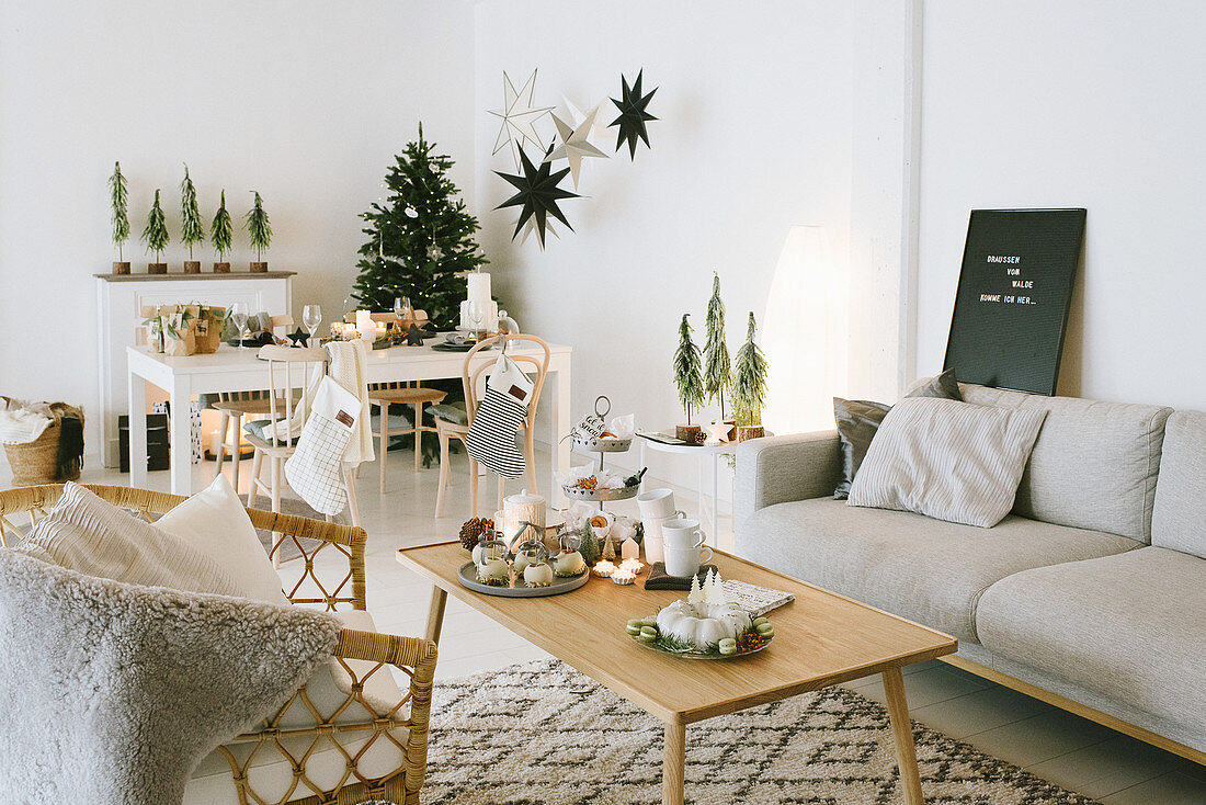 Lounge and dining areas in festively decorated interior