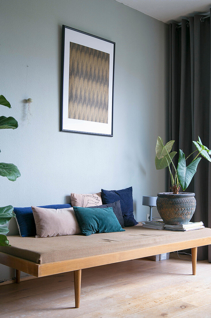 Velvet cushions in shades of blue on 50s couch