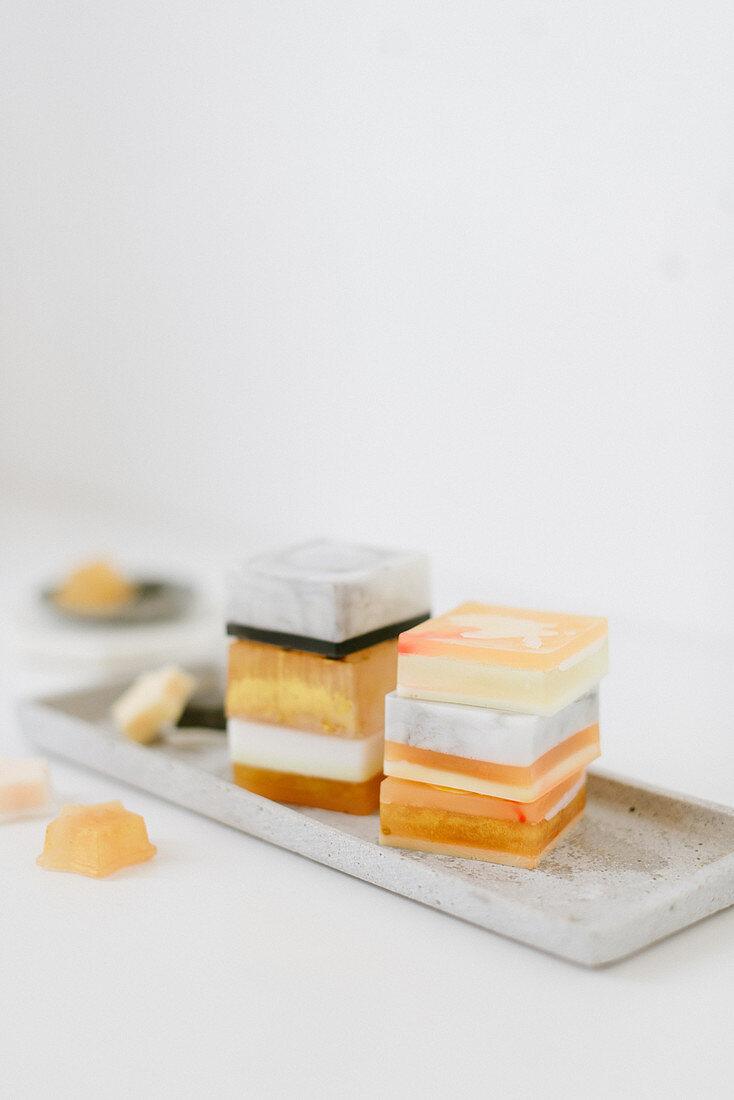 Stacks of handmade soaps on tray