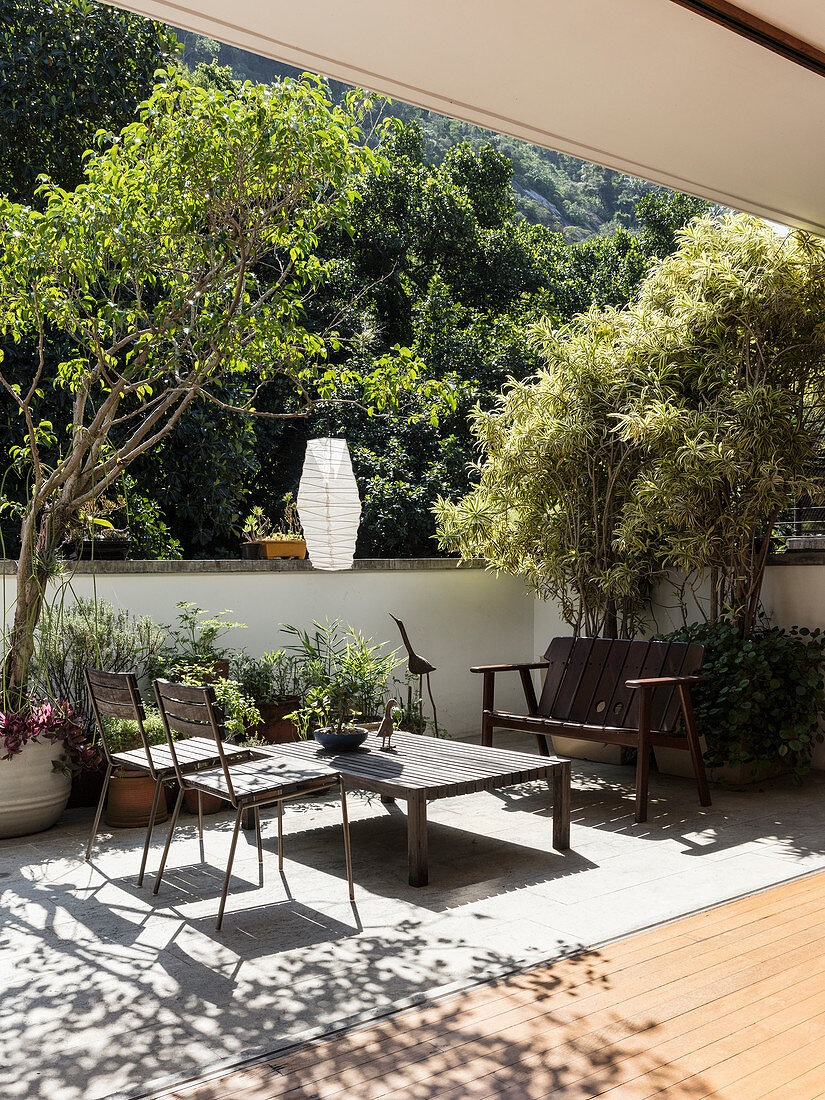 Open façade leading onto sunny terrace with seating area