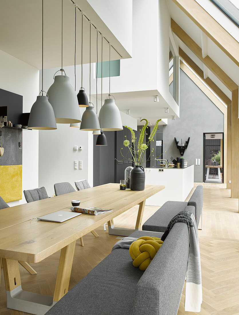 Dining room in shades and grey and white with many wooden elements in architect-designed house