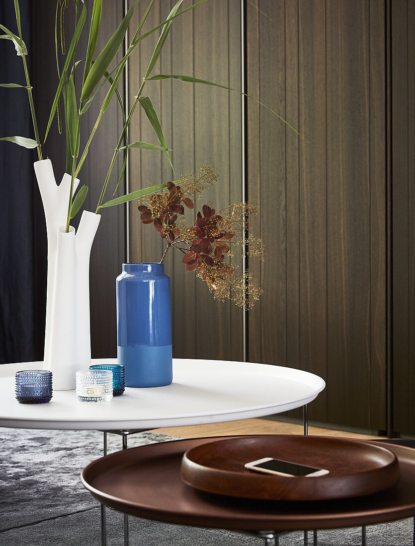 Vases and accessories on two round coffee tables