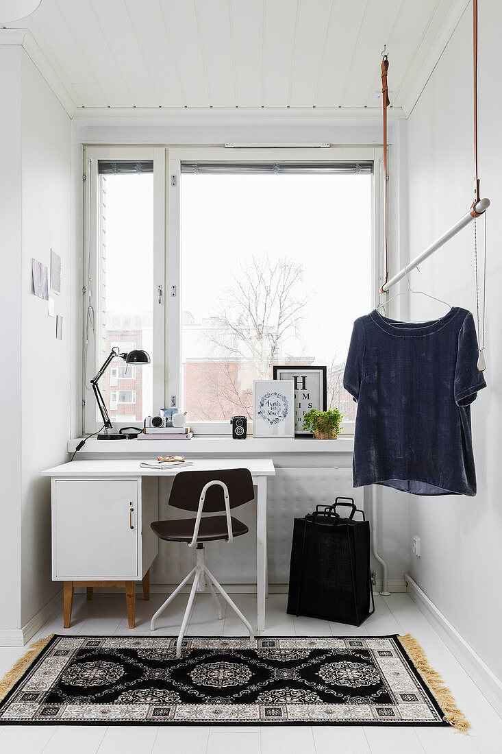 Work area and clothes rail in narrow room