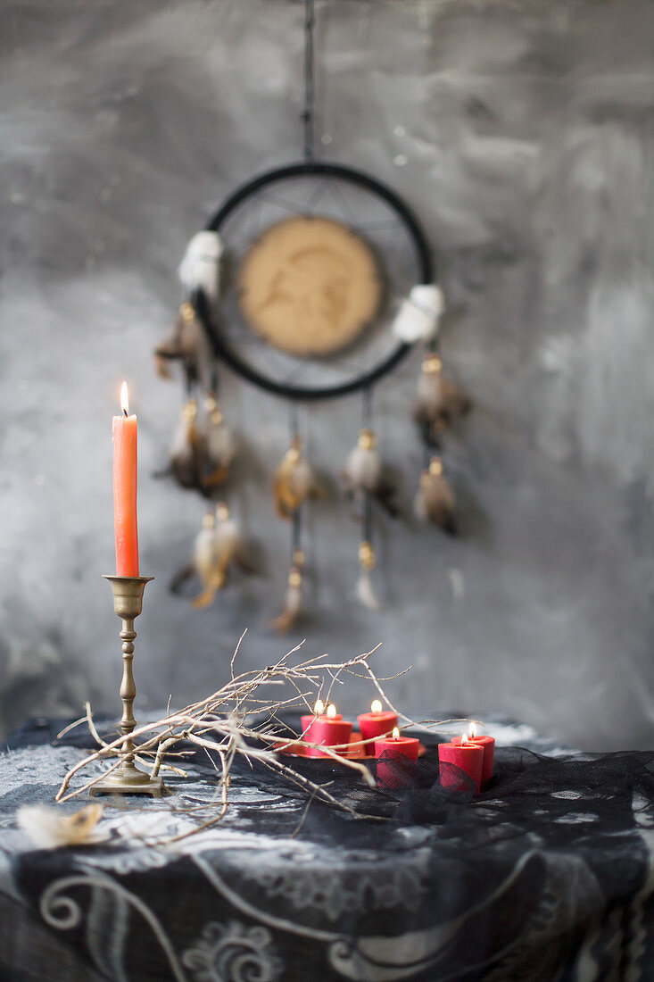 Arrangement of mystical, ethnic accessories in grey, black and red