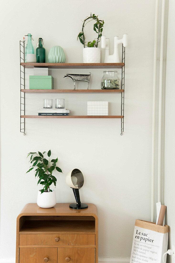 Mint-green and white ornaments on designer shelves