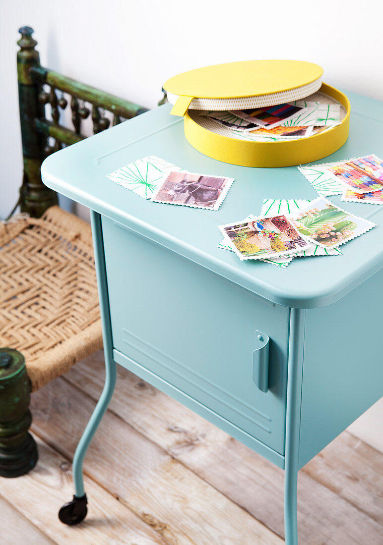 Memory card game made from holiday photos on blue metal cabinet