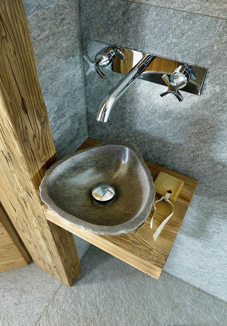 Stone sink on rustic wooden board