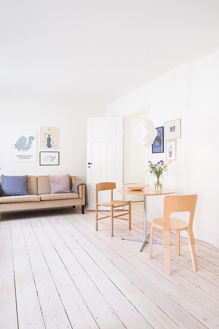 Small dining area in bright, simply furnished living room