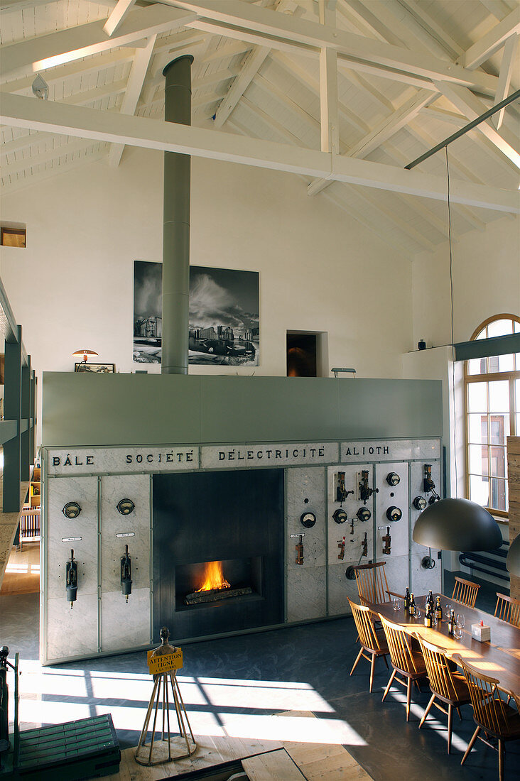 Fireplace fitted in old control console used as partition in converted loft