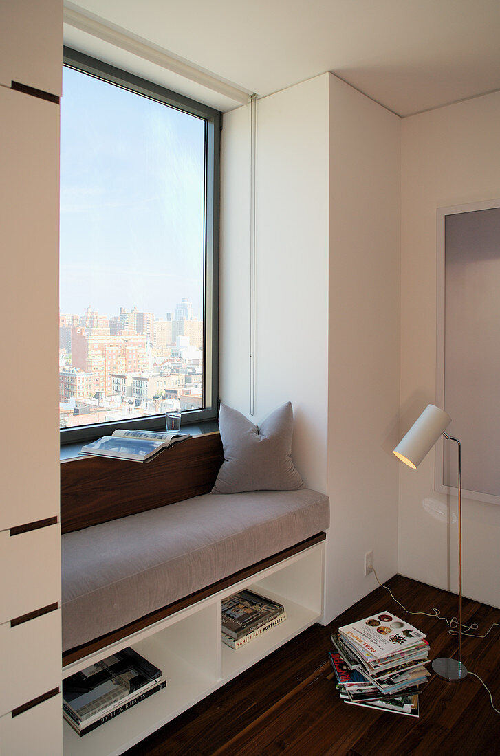 Fitted, upholstered window seat in window niche