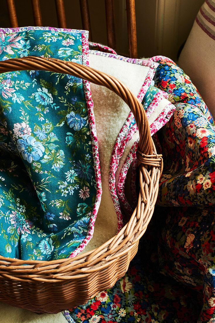 Floral blankets in wicker basket