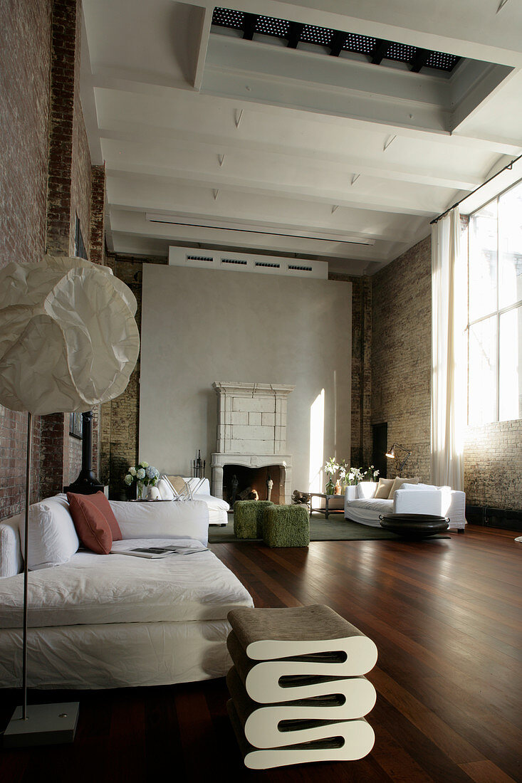 Large living room in industrial building with high ceiling